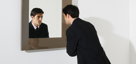 businessman-looking-in-mirror-pan_12170